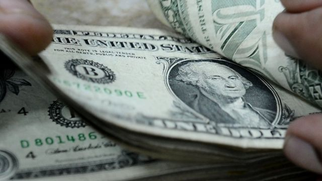 US dollar notes being counted