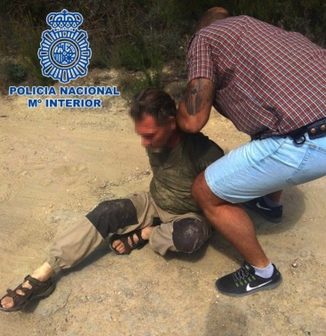 A close-up picture of Jos Brech's arrest by Spanish police