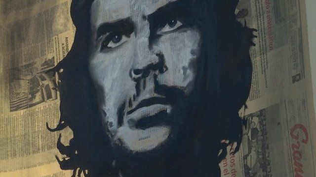 Graffiti-style depiction of Che Guevara, using newspapers as a canvas