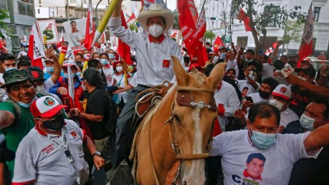 Peruvian presidential candidate for the radical leftist party Peru Libre (Free Peru), Pedro Castillo, rides a horse holding a giant pencil during the closing rally of his campaign in Lima on April 8, 2021