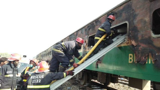 Pakistan firemen board the train that set alight on 31 October