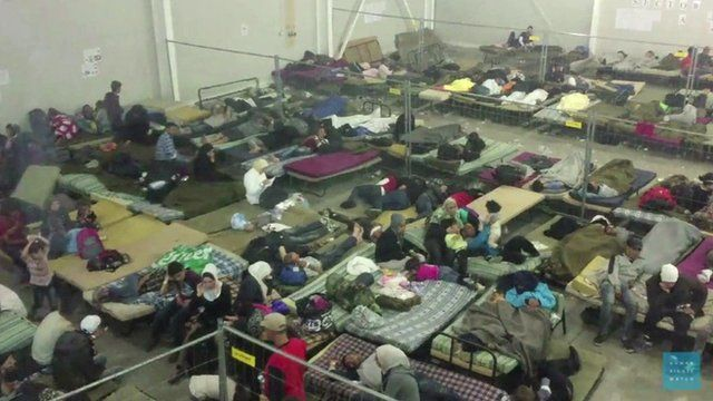 Migrants sleep in a detention centre