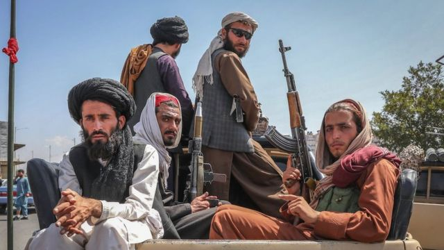Taliban fighters are seen on the back of a vehicle in Kabul, Afghanistan, 16 August 2021.