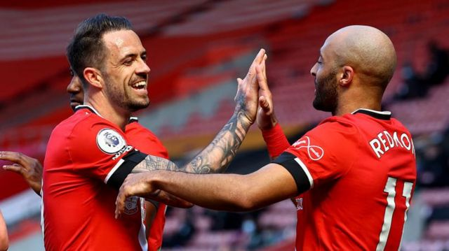 Danny Ings and Nathan Redmond celebrate a Southampton goal against Burnley