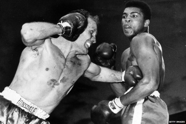 Muhammad Ali, then known as Cassius Clay, and Henry Cooper