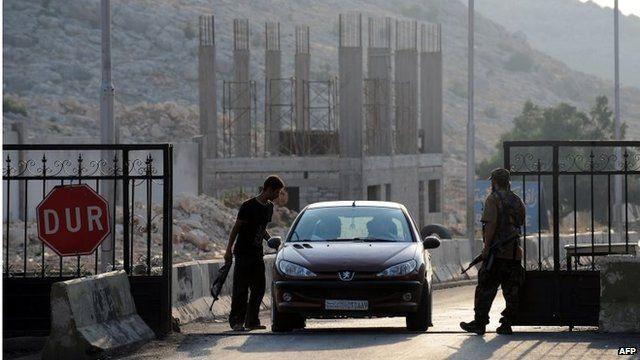 Rebels on Bab al-Hawa border gate between Turkey and Syria (file photo)