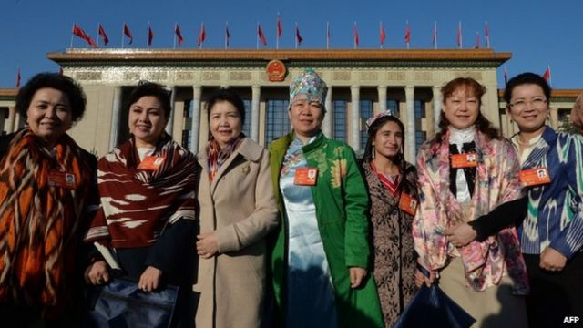 Chinese Uighur delegates from Xinjiang province arrive for the first session of the National People's Congress (NPC) at the Great Hall of the People in Beijing on 5 March 2014