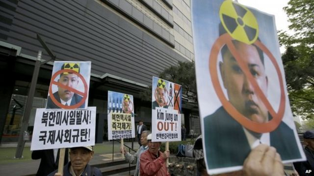 South Korean protesters hold pictures of North Korean leader Kim Jong Un during an anti-North Korea rally against recent missile launches and provocative acts, on the birthday of its founder, Kim Il Sung, in Seoul, South Korea, Tuesday, 15 April 2014