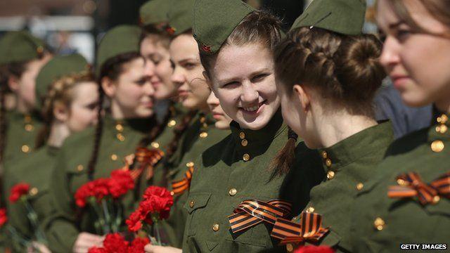 Schoolgirls wear historical uniforms