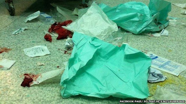 A picture that shows blood and mess on the floor of an operating room