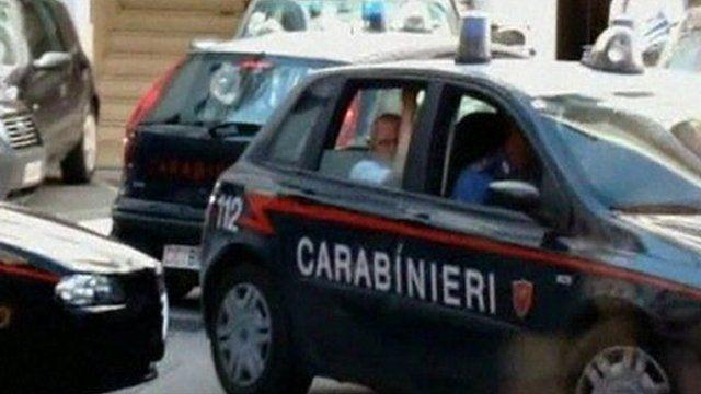 Police arresting suspected mafia