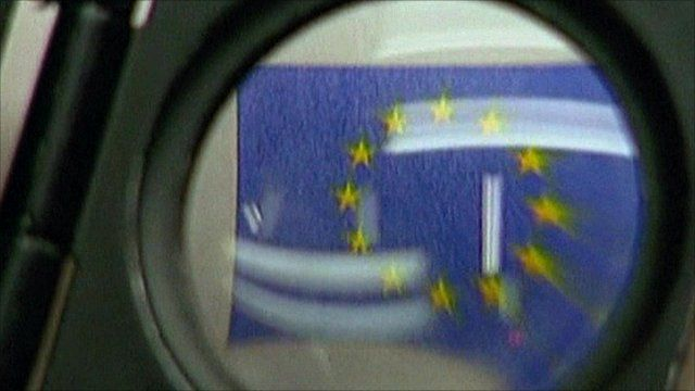 Europe flag behind magnifying glass