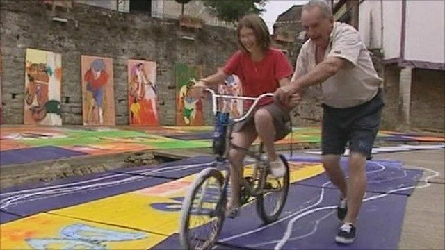 Man with girl on bike