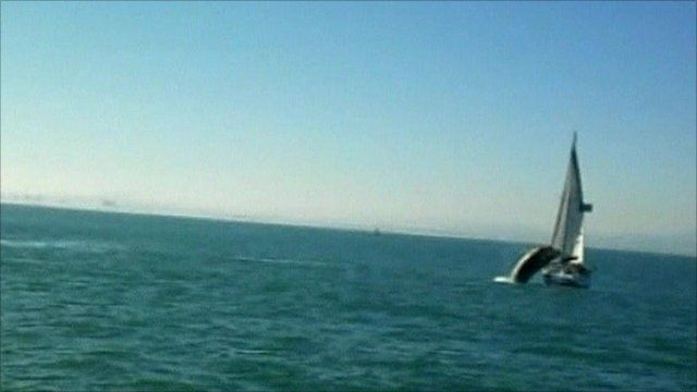 Whale breaching next to boat