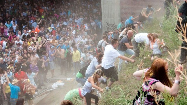 Revellers rush up a hill