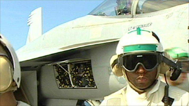 Flight deck crew member prepares an aircraft for flight