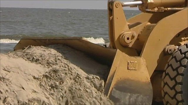 A digger moving sand