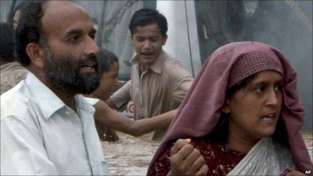People wading through water