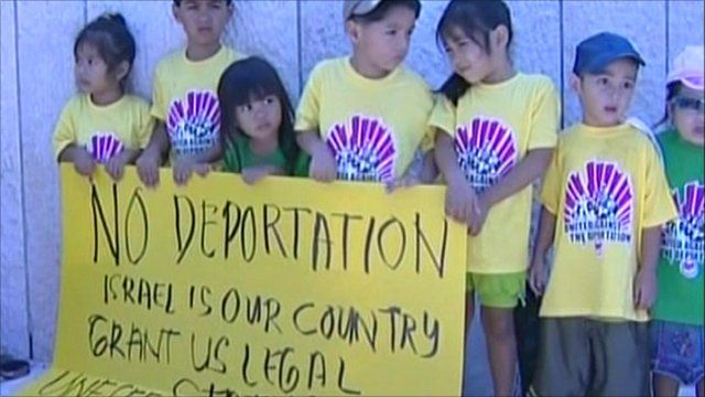 Children holding 'no deportation' sign