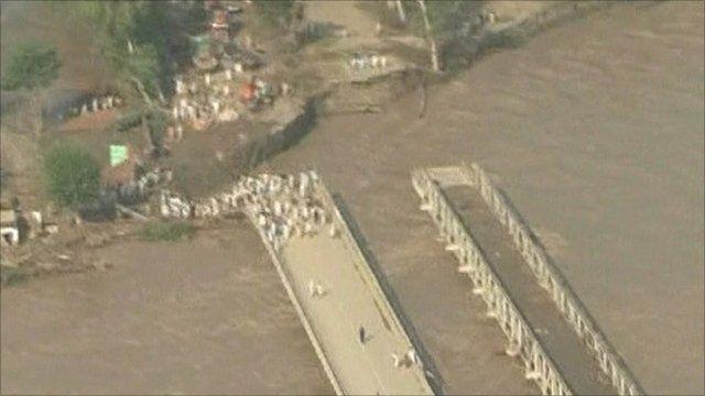 The rain damages a bridge