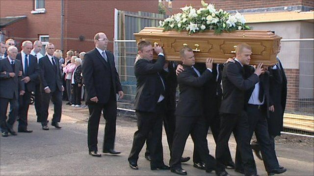 Mourners carried the coffin