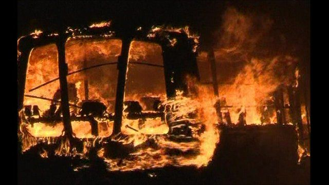 A bus set alight during violence