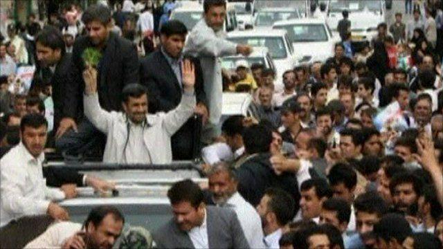 President Ahmadinejad waving to crowds