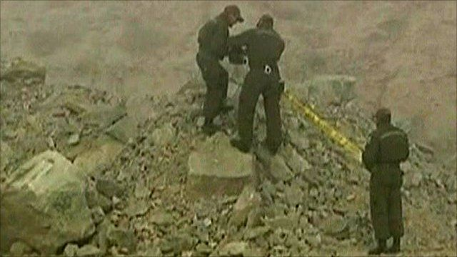 Rescue workers at collapsed mine