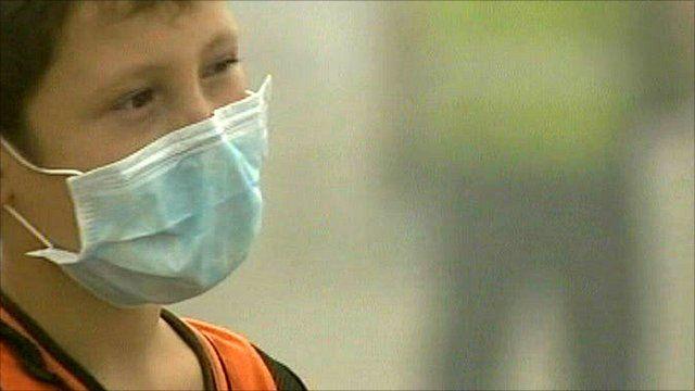Boy in face mask