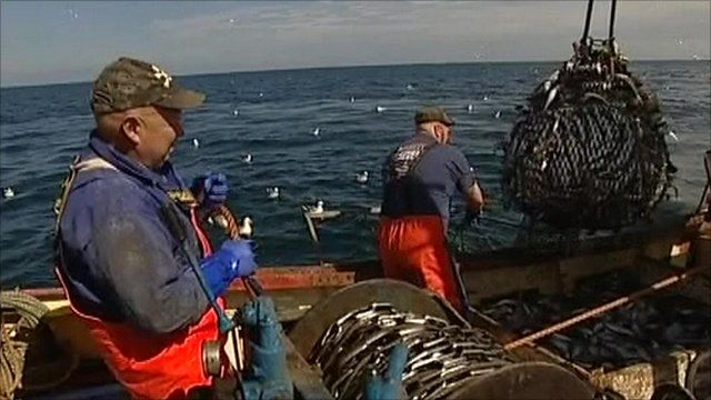Fishermen hauling in catch on the North Sea