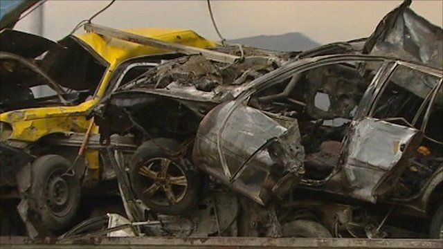 Wreckage of cars caught in roadside bomb