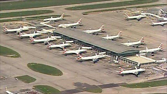 Airplanes waiting at a terminal