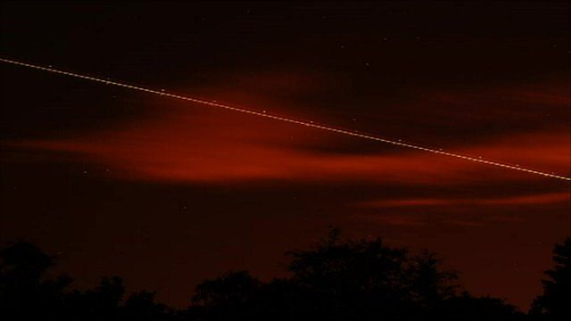 A meteor streaks across the night sky