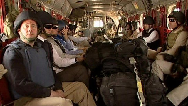Liam Fox in a military helicopter