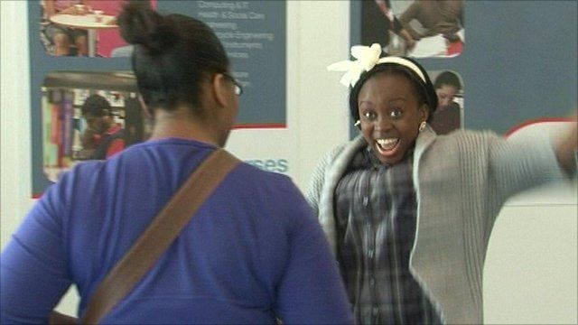 A student celebrates her results
