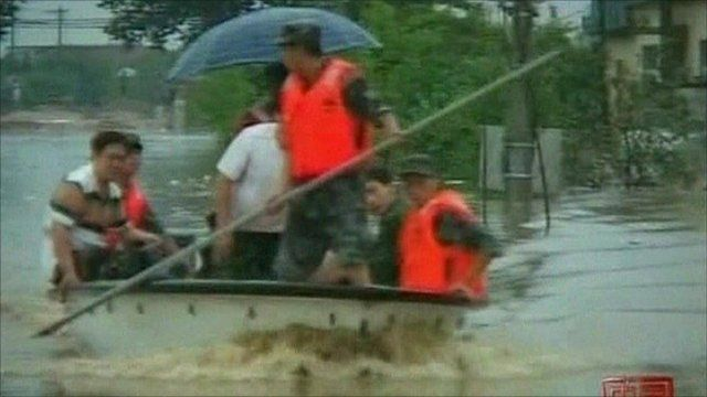 Chinese forces rescuing people in floods