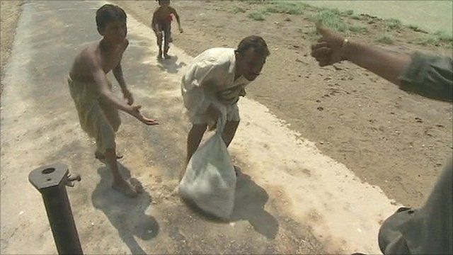 Aid is handed out to desperate Pakistanis