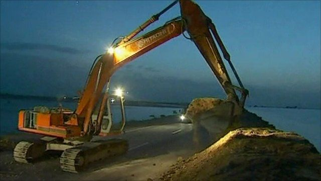 Flood defences being built by a digger