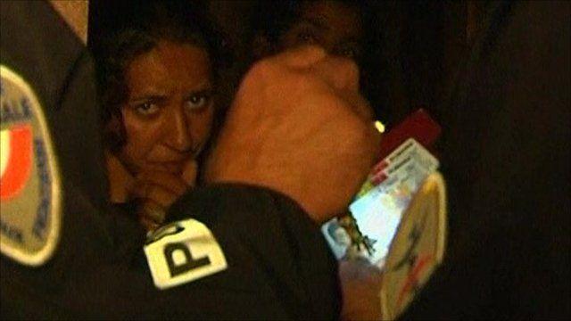 Police raid a Roma camp at night