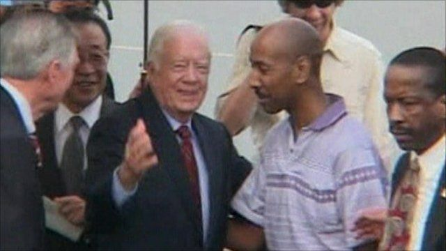 Former President Jimmy Carter and Aijalon Mahli Gomes