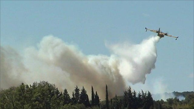 Emergency services try to extinguish France wildfires