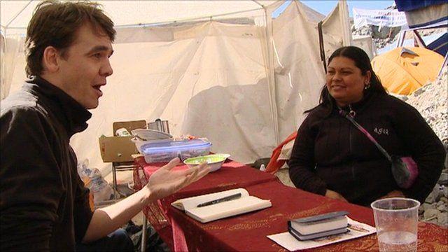 Mark Reynolds talking to Cristina Nunez Mecias, partner of trapped miner