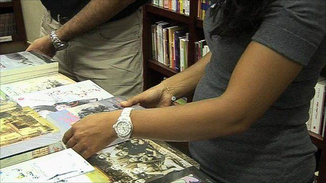 People browsing through books