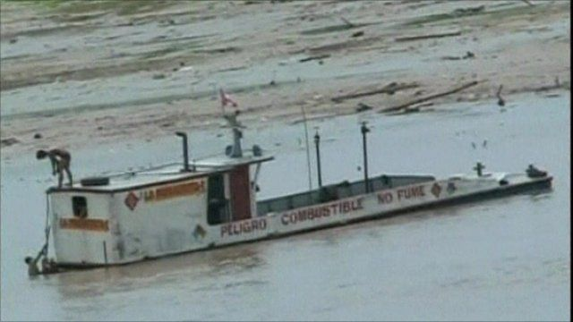 A boat stranded in shallow water