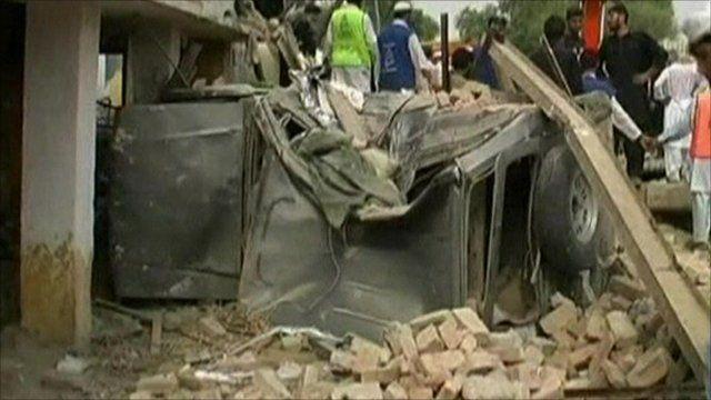 car lies under rubble