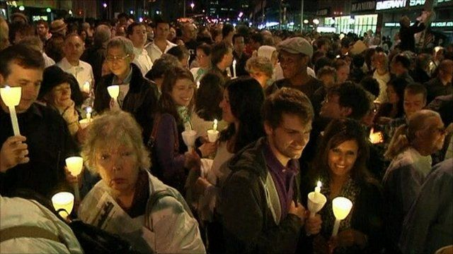 People holding candles at the vigil