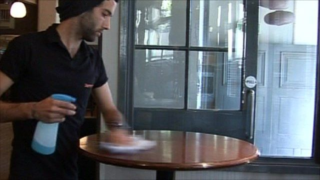 Man cleaning restaurant table