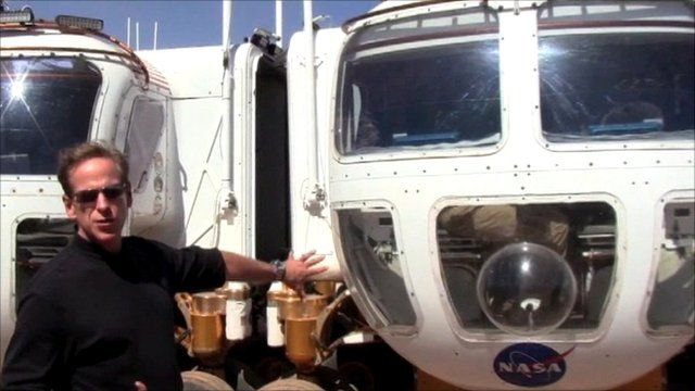 Nasa astronaut Mike Gernhardt with two rover prototypes