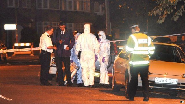 Police at the scene of attack on Dr Imran Farooq in Edgware
