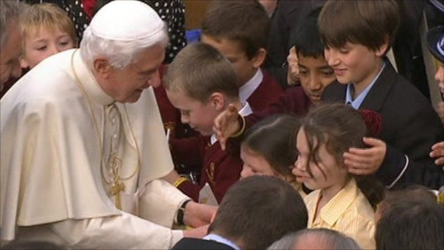 Pope being greeted by children